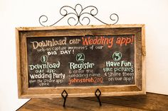 This couple created a colorful board to inform guests about their Wedding Party app and match their decor!