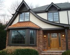 Tudor Style Home Exterior. Tudor House, Tudor Style Homes, Storybook Cottage, Roof Lines, Traditional Exterior, Basement Renovations, Bay Window, Gazebo, Outdoor Structures