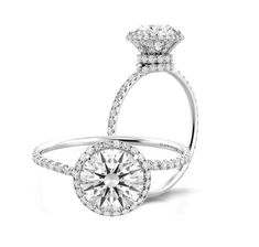 Do you fancy dainty ring designs but still love the look of a halo? How about this lovely Solo Filo engagement ring by Danhov, a subtle endearing halo from the front and an intriguing swirl of diamonds from the side? Encrusted with approximately hundred petite F/G VS diamond accents, this ring surely is a no-brainer, wouldn't you agree? www.diamonds.pro