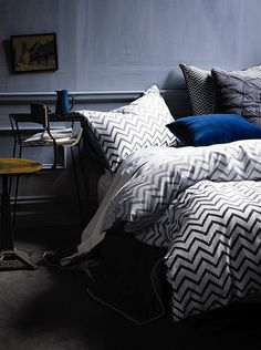 Soft, modern chevron bedding from AURA by Tracie Ellis. I love how that navy velvet pillow just pops.