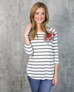 We love our I'm Yours Striped Floral Applique Top for it's simplicity and modern vibe. This super soft and stretchy long sleeve is comfortable for winter and ve