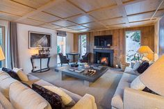 Chalet Taupiniere Courchevel 1850 living area with sofas and fireplace