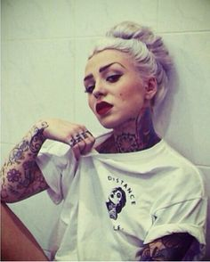 Tattoos and platinum blonde. Badass.