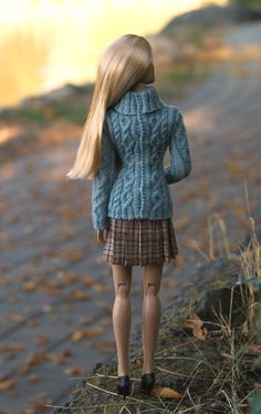 This knitting pattern can help you create a detailed aran sweater, like the ones pictured here. This fisherman-style Aran turtleneck is modeled after a beautiful sweater from Eddie Bauer. The cable pattern is complex, worked with small knitting needles. This pattern is for advanced knitters.  The sweater may fit a variety of 16 inch dolls, but is specifically fitted to Robert Tonners 16 Ellowyne or Tyler Wentworth. The sweater is completely open in the back for ease of dressing. The body is…