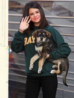 It was love at first sight for Selena Gomez and her husky mix puppy! Click to see more adorbs photos: http://www.peoplepets.com/people/pets/gallery/0,,20613689,00.html