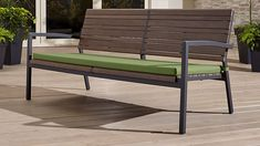 OUTDOOR FURNITURE: green cushion with wood back; Rocha II Sofa with Sunbrella ® Cushion