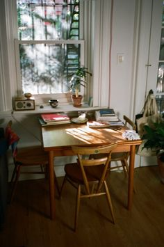 Beautiful calming workspace by a window. A perfect place for morning coffee and sketching.