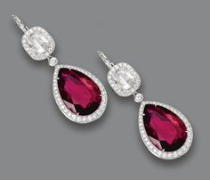 PAIR OF RUBELLITE AND DIAMOND EARRINGS.  The 2 pear-shaped rubellites together weighing approximately 19.00 carats, surmounted by 2 cushion-shaped rose-cut diamonds weighing approximately 1.60 carats, bordered by numerous small round diamonds weighing approximately 1.95 carats, mounted in platinum.