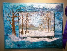 https://flic.kr/p/rsRWm | Small Quilt: Winter Landscape | This won Judge's Choice for the Small Quilts.  I love the way the road picture is framed by the larger composition.  And the quilting of the snow on the road!  Brilliant!