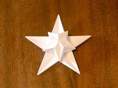 INSANE origami puff star--might need to recruit my brother or my genius 11-year-old nephew to fold this baby for me :)