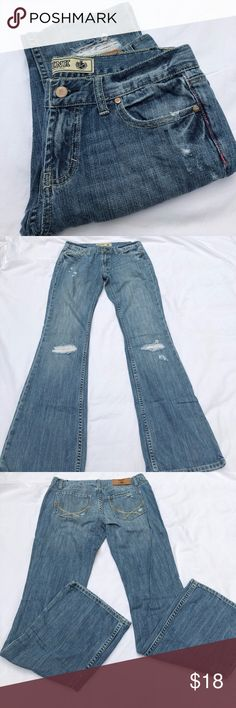 """VS Pink Bootcut Jeans 6S Distressed Bootcut Jeans from Victoria's Secret Pink. Size 6S (Short) so are marked here as petite. See pics 4 and 5 for dirt stains at back of ankle. Measurements: Waist across laying flat-15 1/2"""" Rise-7 1/2"""" Inseam-31 1/2"""" Hips across at widest laying flat-19"""" Thigh across at widest-10 1/2"""" Ankle width-9"""" No: rips or holes, other than those that are intentional. Smoke free home. PINK Victoria's Secret Jeans Boot Cut"""