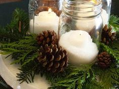 diy-christmas-table-centerpieces quick-and cheap Christmas Table Centerpieces, Jar Centerpieces, Centerpiece Decorations, Decoration Table, Wedding Centerpieces, Christmas Decorations, Christmas Candles, Pinecone Centerpiece, Pinecone Decor