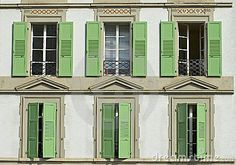 Windows with wooden shutters