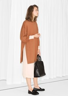 Round neck Relaxed straight fit Ribbed trims Model wears: S Length of tunic: 88 cm