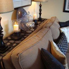 Thin table against sofa & wall