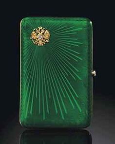 AN IMPERIAL PRESENTATION CIGARETTE CASE BY FABERGÉ, WORKMASTER'S MARK OF AUGUST HOLMSTRÖM, ST PETERSBURG, 1899-1904 Rectangular with rounded corners, the body enamelled in translucent green over a sunburst guilloché ground, the upper left corner of the hinged cover applied with a diamond-set Imperial double-headed eagle, with rose-cut diamond push-piece. Provenance: By family tradition, presented by Emperor Nicholas II to Captain John Nicholas, Superintendent at the Royal Mews, London.