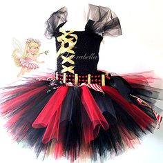 Y'argh! A beautiful pirate princess dress, I made a detachable sword belt and also made some bunting which is wrapped around the waist, layers of gold, red and black tulle are attached to a black crochet top with adjustable ribbon shoulder straps.