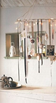 Pretty mobile. Would be fun to do with vintage mercury glass ornaments and colorful ribbons for Christmas.