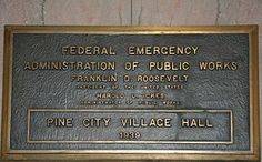 PWA project plaque, using the name Federal Emergency Administration of Public Works, on the Pine City, Minnesota City Hall