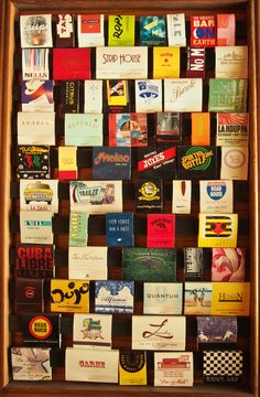 """Cool Framed #Matchbook Wall hanging #matchdisplay comprised of horizontal wooden rungs in which the colorful #advertisingmatchbooks are """"hung"""" to display as #wallart. To order your business' own branded #matchbooks Goto: www.GetMatches.com or call 800.605.7331 TODAY!"""
