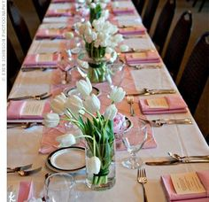 Simple tulip centerpieces for a long banquet table - I like the banquet idea better than round tables.