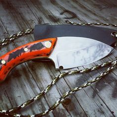 """Orange Squid Neck knife. This little beauty is hand crafted from 01 tool steel heat treated, and etched, finished to a high polish. The blade is 2.1/2"""" long, 5.1/2"""" overall. The scales are made of poly micarta and brass lining . The holster is Kydex with 4 feet of paracord. Not a prop, a very sharp blade! All designs are my own, I will be creating more in the squid line with similar dimensions but no two will ever be the same. This blade will always be a one of a kind! #knife #knifeporn…"""