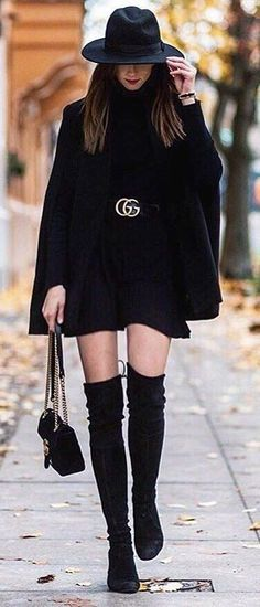 Black Coat // Black Dress // Knee Length Boots // Black Hat                                                                             Source