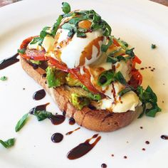 Crunchy bread, avocado, grilled tomato, bocconcini, poached egg, basil and balsamic vinegar