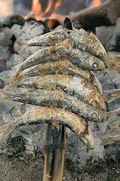 Sardine Skewer or espeto de sardina.  Favorite thing ever!   Try it when on any Spanish coast....you won't regret it!