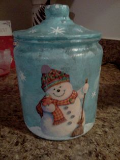 Christmas cookie jars made using decoupage, cut out pictures and paint