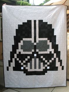 Pixel Star Wars Darth Vader quilt with minky back - pattern on Etsy.  Easier than it looks and very fun to make.