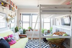 Andy & Danielle's Cozy, 325 Square Foot Chicago StudioWhen space is limited in a studio, it's common to cram in just the essentials: a space for sitting, a loft bed, and a small cooking area. But Andy and Danielle went a step further to include a window garden, meditation space, reading nook, and a bar. The end result? A cozy Chicago apartment full of color and lots of love.