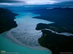 The Tlikakila River flows into Alaska's Lake Clark carrying ash from Iliamna, one of two volcanoes in Lake Clark National Park and Preserve.  Photographer:  Michael Melford, NatGeo