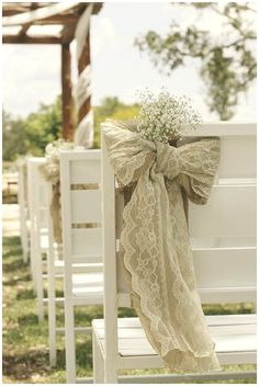 40+ Hessian Wedding Ideas - hessian and lace chair bahs tied in bows for wedding ceremonies #weddingideas #hessianwedding #rusticweddingideas