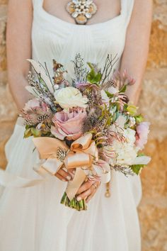 Style Me Pretty | Gallery | Picture | #563932 soft colors and textures with feathers and jasmine