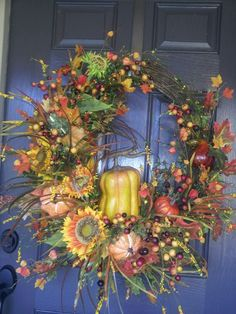 Fall grapevine wreath w/sunflowers, squash, berries by kyong