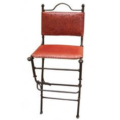 Southwest Furniture :-  Wow! solid iron with lwather seat and hand tooled leather back! This is a very unique bar stool that will compliment any spanish colonial, southwest or rustic  decor.