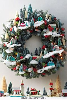 This holiday season, decorate your front door with this DIY holiday village wreath with our step-by-step tutorial for this beautiful handmade craft. #marthastewart #christmas #diychristmas #diy #diycrafts #crafts