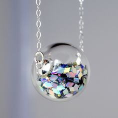 I found 'Prism glitter in hand blown glass ball necklace' on Wish, check it out!