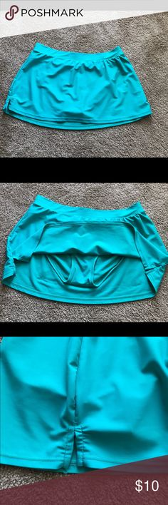 Tropical Honey Bathing Suit Skirt w/Panty (sz 14) Deep turquoise bathing suit skirt with attached panty; slits on sides. 81% nylon, 18% spandex.  Used but in excellent condition. Tropical Honey Swim