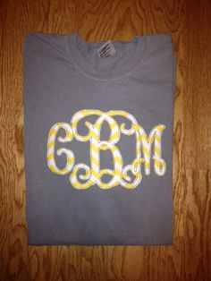 Applique monogrammed T-shirt    This is a T-shirt with applique monogram. The size is approximately 6 inches in height x 9.5 inches in length. When