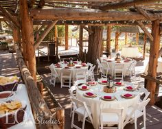 Hidden Creek, rustic wedding reception venue in Lake Arrowhead area surrounded by forest. Photo by Love One Another Photography