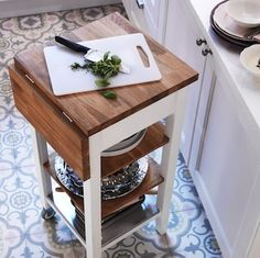 """Even in a small space, try to achieve the """"work triangle,"""" that optimal configuration between the stove, refrigerator, and sink. Rolling carts offer storage and workspace, and their mobility frees up built-in space to accommodate the triangle."""