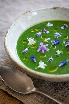 asparagus soup with chive oil and edible flowers from the garden