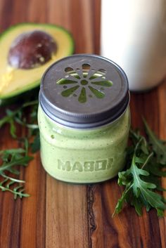 Green smoothie with avocado, arugula and almond milk