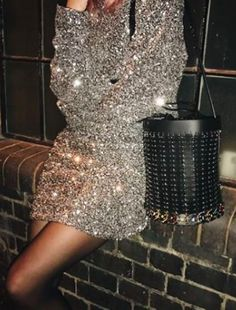 Shop now. Courtney Trop @alwaysjudging wears Paco Rabanne leather bucket bag with medallions linked with silver rings, inside pouch with drawstring.