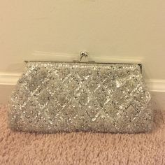 Fellini White Pearl Sparkle Clutch Used once for my wedding  See photos. It has some bronzer on it and inside. Just a little. Bags Clutches & Wristlets