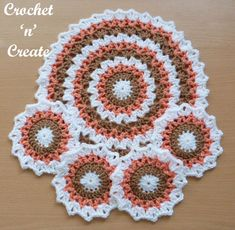 Pretty edged circular crochet mat-coaster set, I have used warm Winter colors, but they would look just as nice in bright sunny colors, you ..........