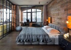 White and Gray Bed Sheets in Industrial bedroom decor ideas with Egg chair by Arne Jacobsen in bedroom office via Igor Martin