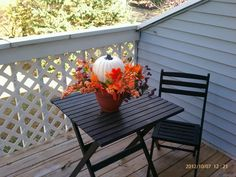 Fall decor! Pumpkin from Michaels! Flowers and pot from dollar tree! Yay fall!